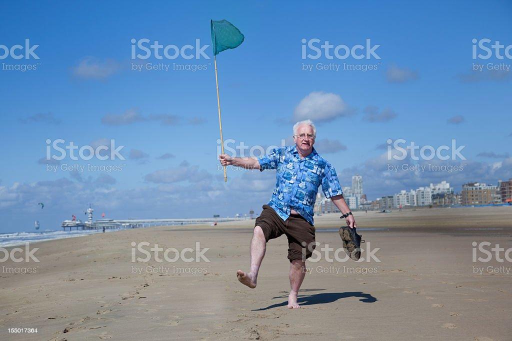 Senior tourist on the beach stock photo