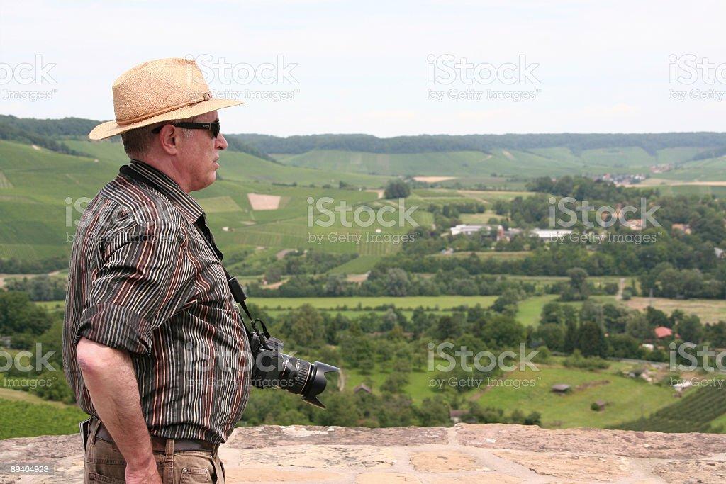 senior tourist with camera enjoys the beautiful view 免版稅 stock photo