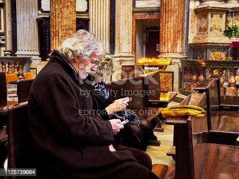 istock Senior tourists in the interior of Real Chiesa di San Lorenzo church. Turin, Piedmont, Italy. 1125739664