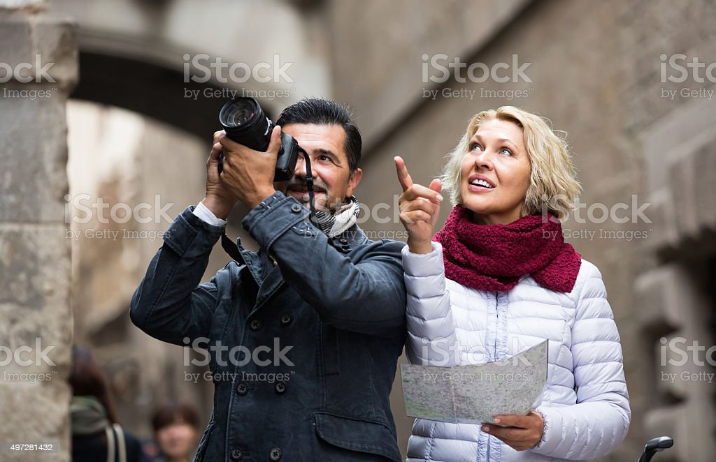 Senior travellers with city map royalty-free stock photo