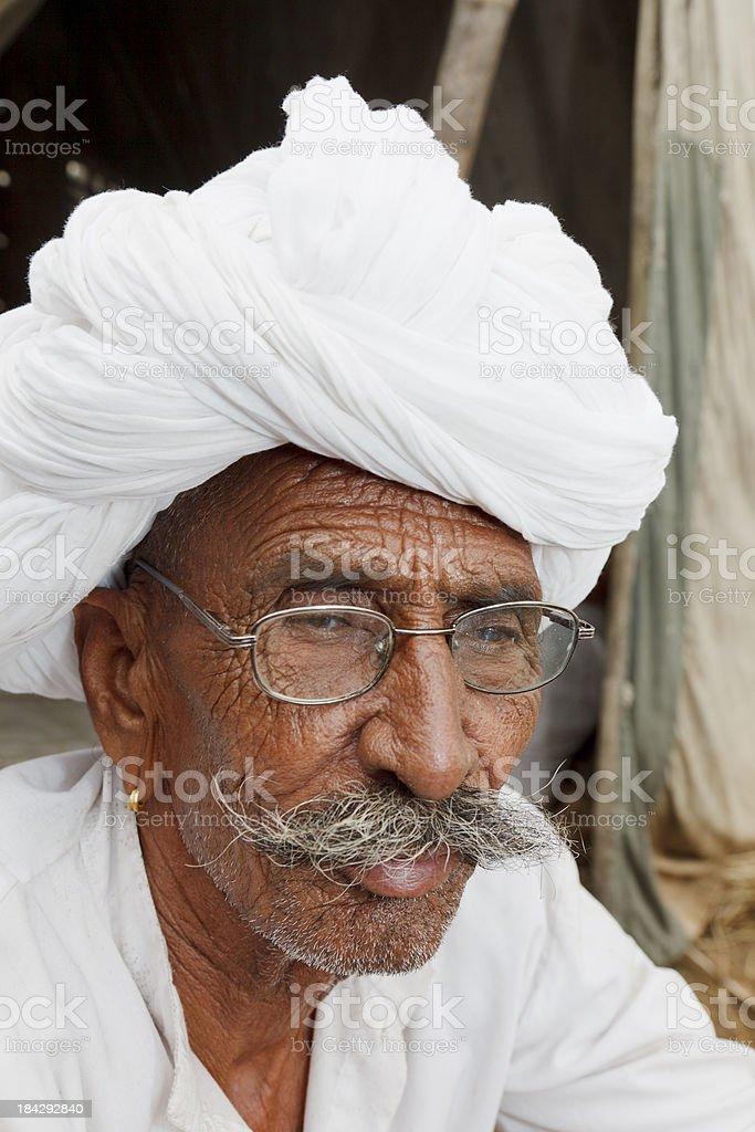 Senior tribal man with mustache and white turban India stock photo