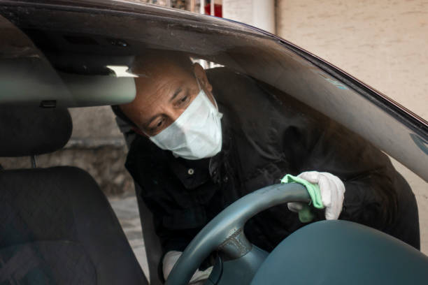 Senior Turkish man disinfects his car stock photo