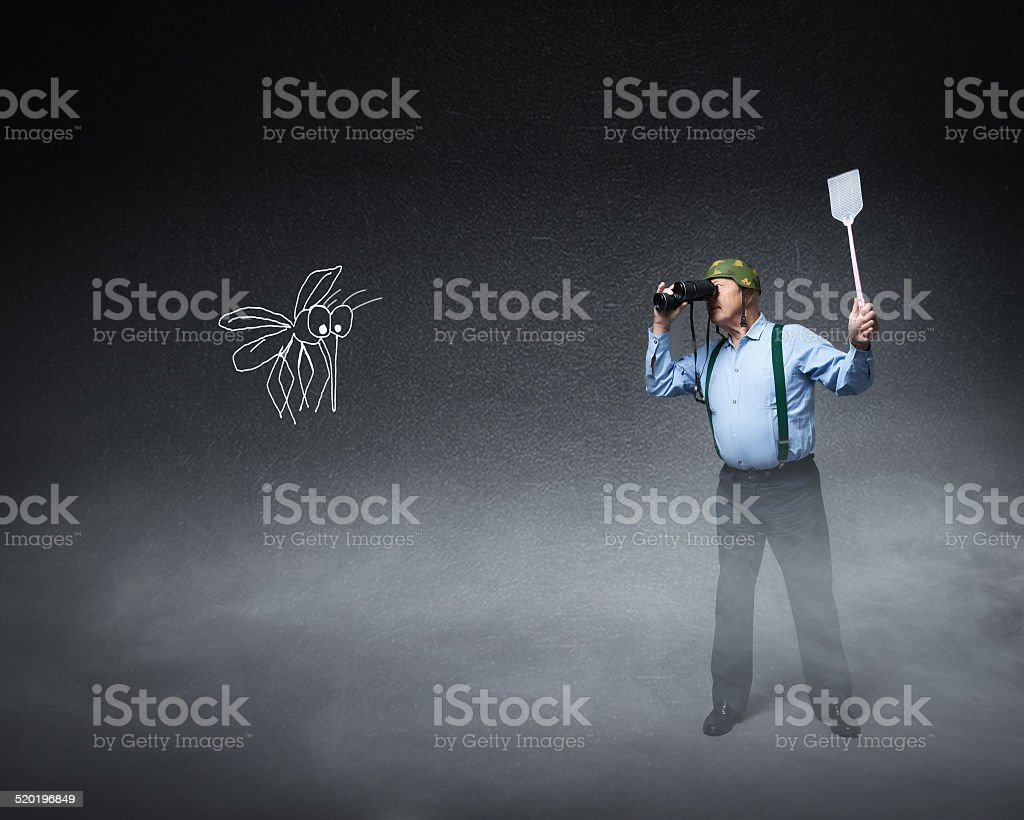 senior veteran military ready to kill mosquito stock photo