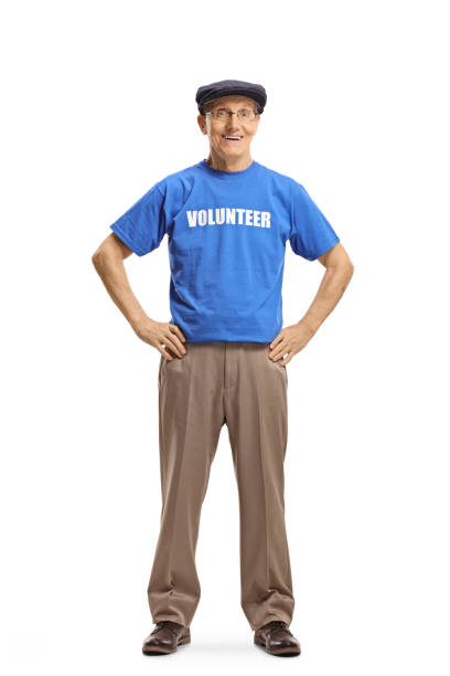 senior volunteer posing and smiling at the camera - contributor stock pictures, royalty-free photos & images