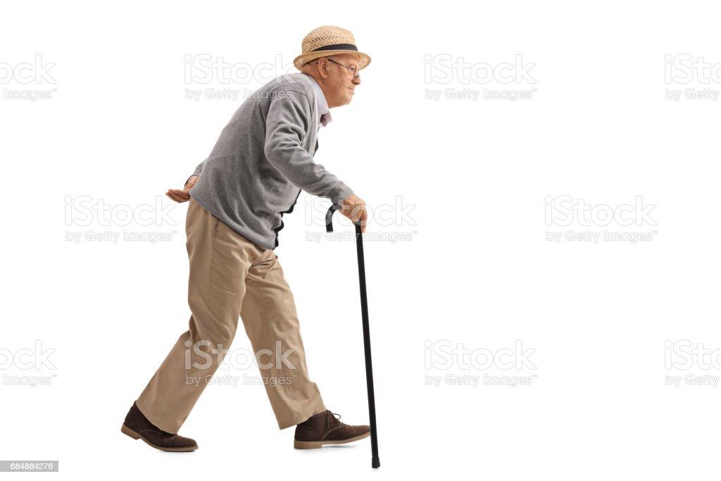 Senior walking with a cane - foto de stock