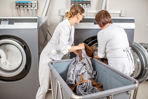 Senior washwoman in the laundry