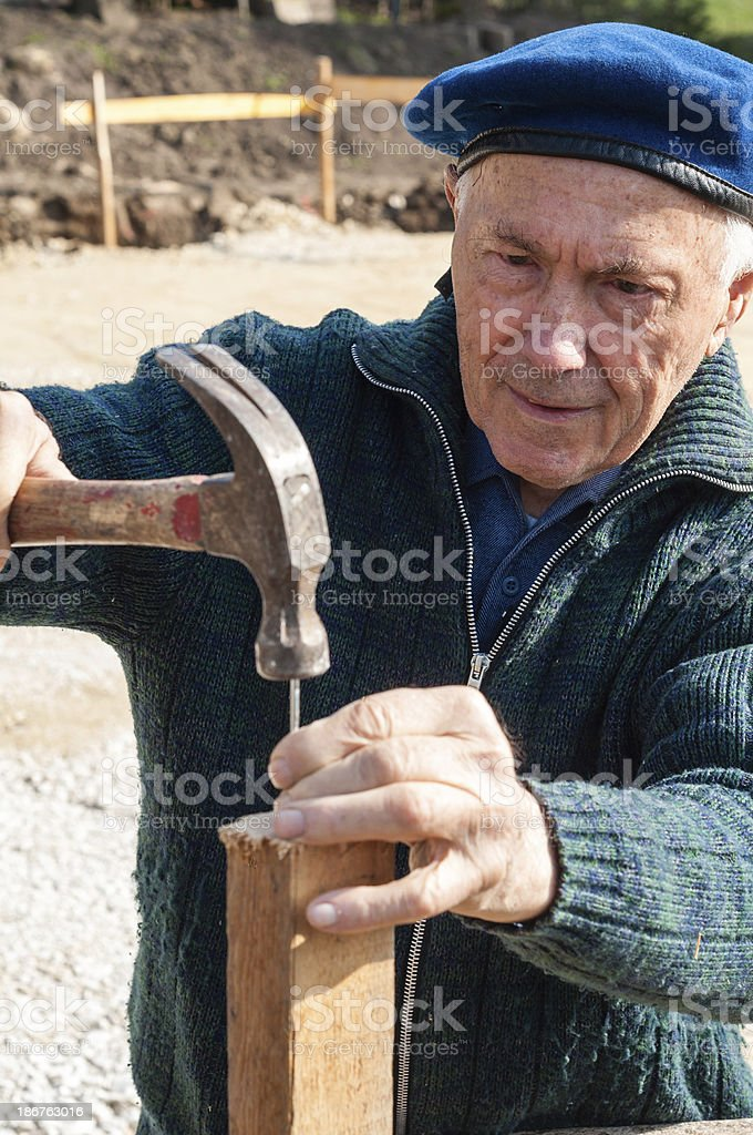 Senior, when nailing. Leisure activity for Pensioner stock photo
