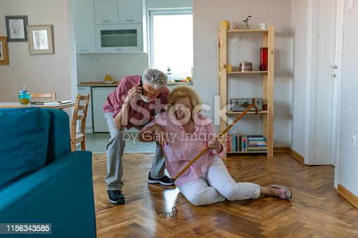 senior men helping at old woman who falled down on floor