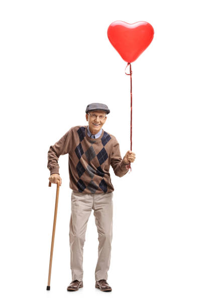 senior with a heart shaped balloon and a cane - senior valentine stock photos and pictures