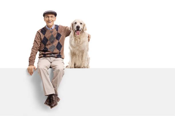 Senior with a labrador retriever dog sitting on a panel picture id918493358?b=1&k=6&m=918493358&s=612x612&w=0&h=lasevq obur02xpp2qci2txq8l 5t0atrrl8katz2go=