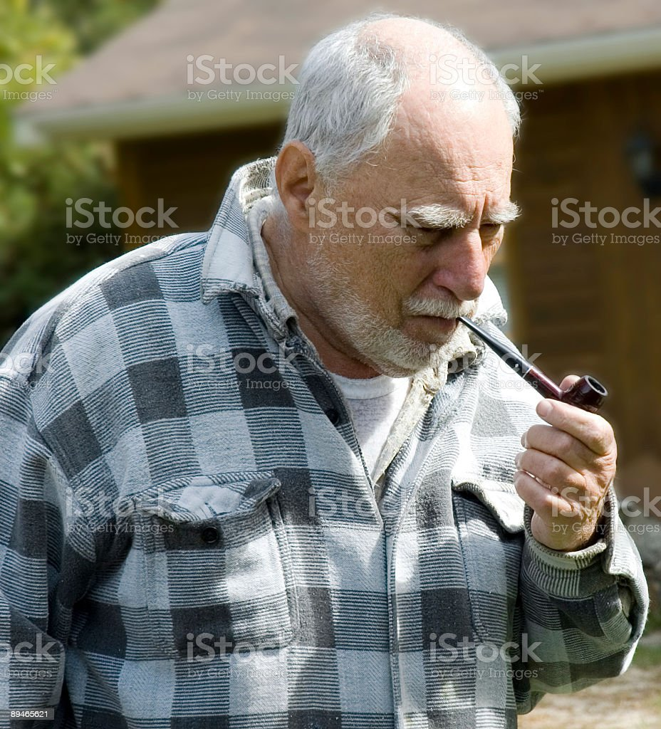 senior with a pipe 1 stock photo