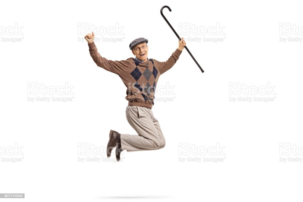 Senior with a walking cane jumping and gesturing happiness stock photo
