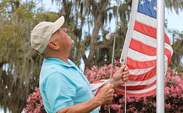 Senior With American Flag stock photo