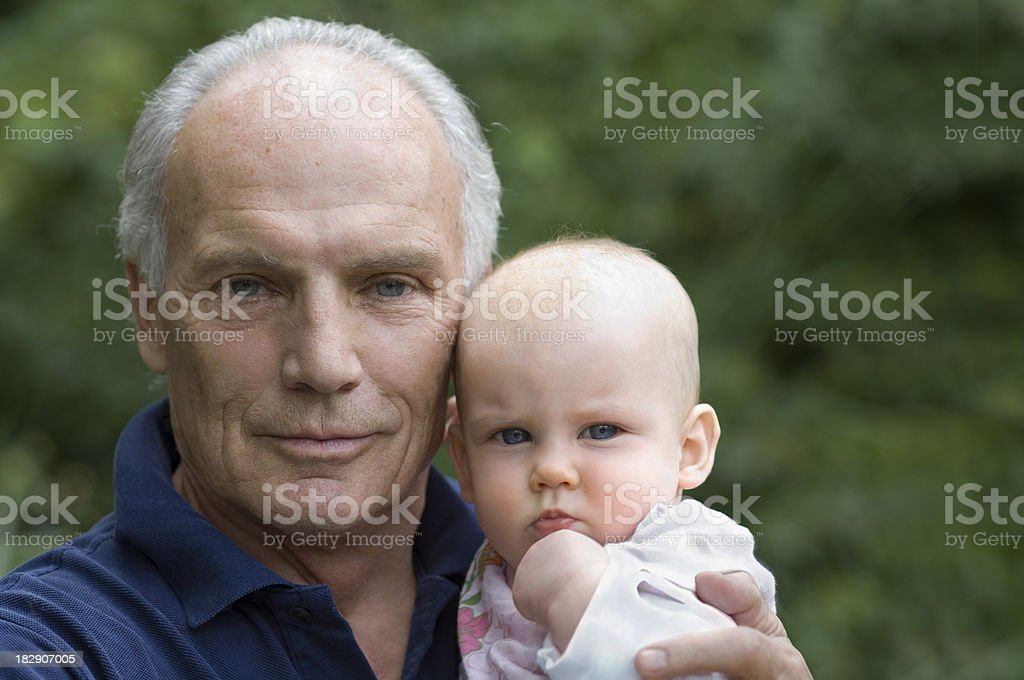 Senior with baby royalty-free stock photo