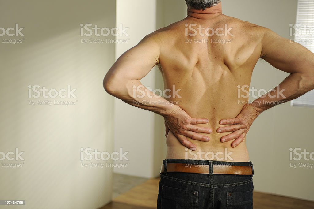 senior with back pain royalty-free stock photo