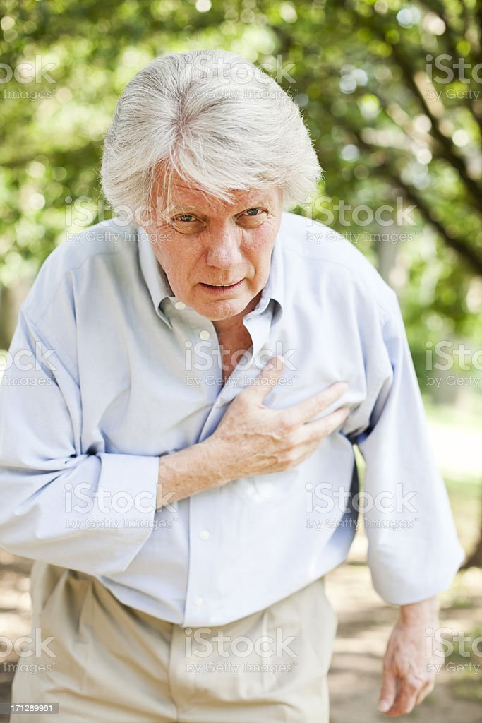 Senior with Chest Pain royalty-free stock photo
