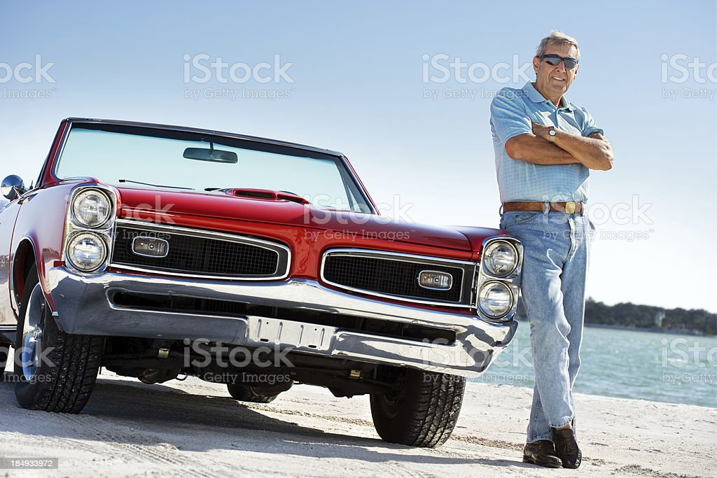 Senior with classic convertible car stock photo