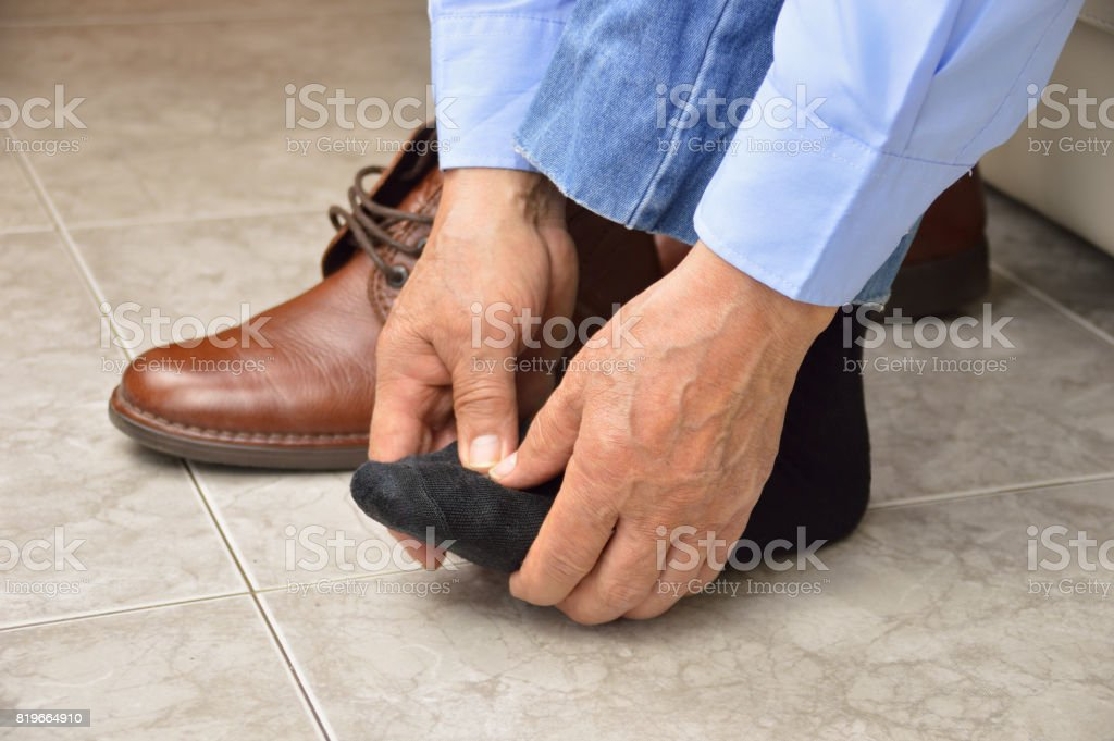 senior with foot pain stock photo