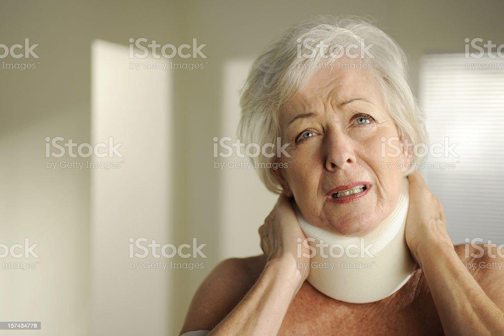 senior with neck brace royalty-free stock photo