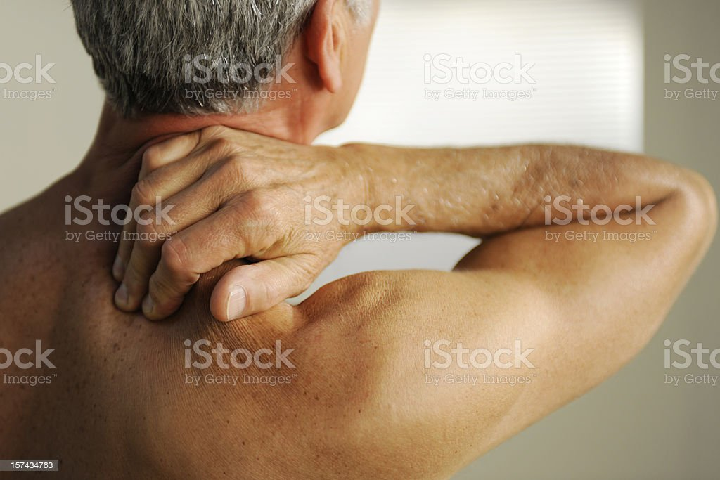 Senior With Neck Pain stock photo
