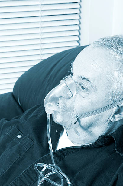 senior with oxygen mask stock photo