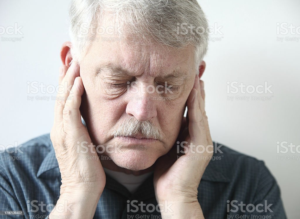 senior with pain in front of ears stock photo