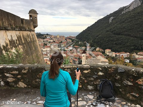 872969580istockphoto Senior woman admires view over town from castle wall 1137322247