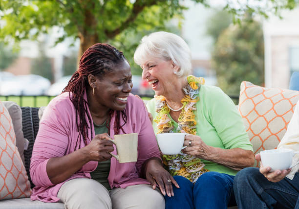 senior woman, african-american friend laughing together - idosos imagens e fotografias de stock