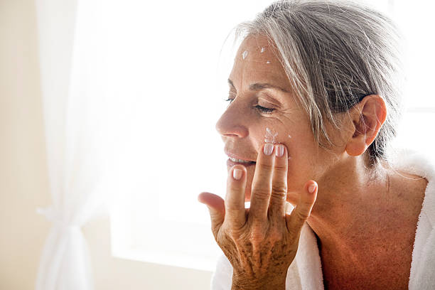 Senior Woman And Body Care stock photo
