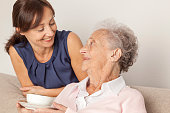 Senior woman and caregiver at home