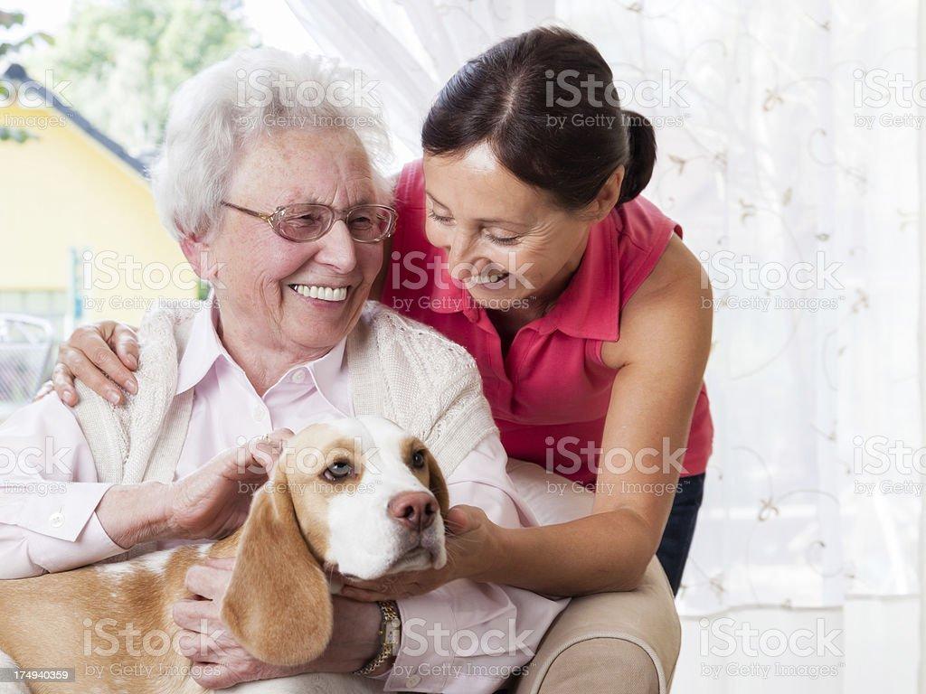 Senior woman and caregiver royalty-free stock photo