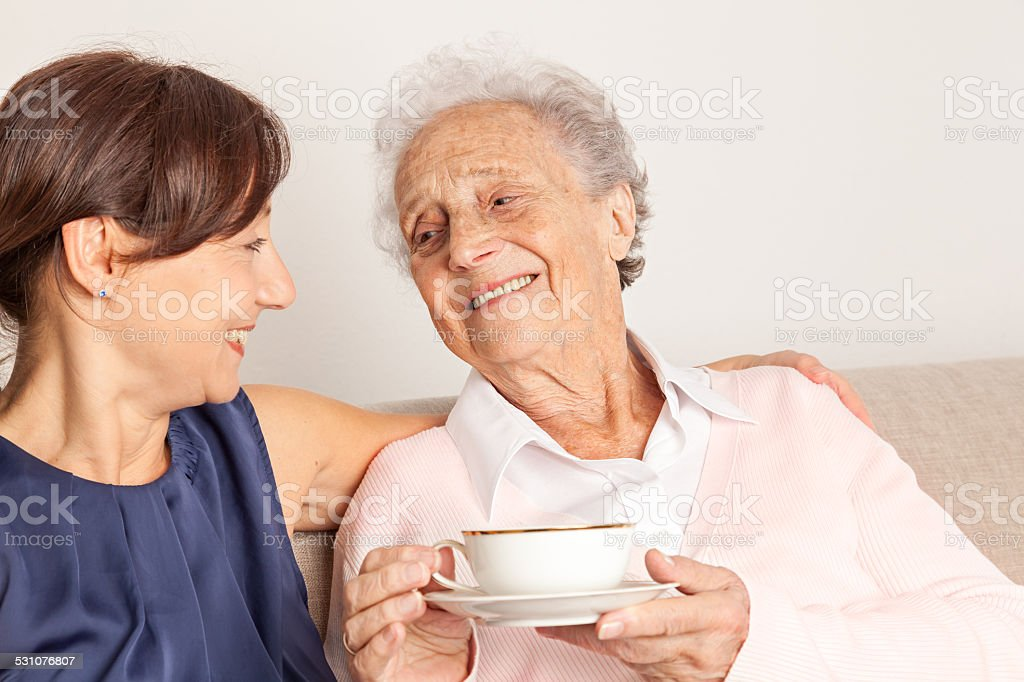 Senior woman and caregiver stock photo