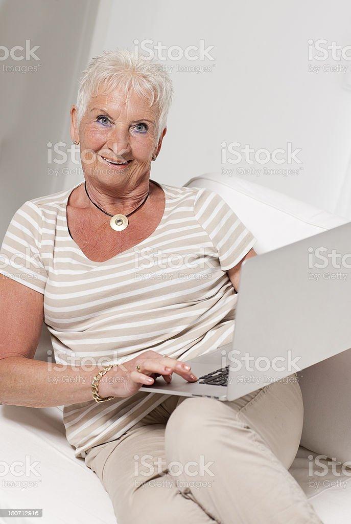 Senior woman and computer royalty-free stock photo