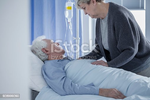 829742744istockphoto Senior woman and dying husband 928999260