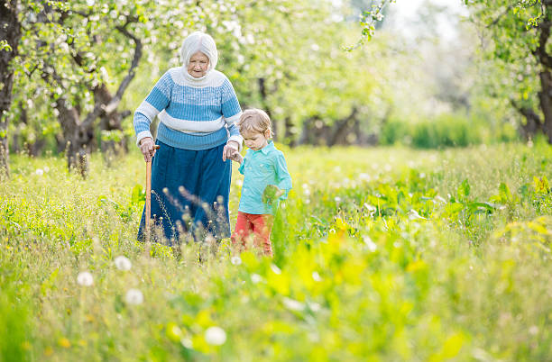 Senior woman and great grandson outdoors stock photo
