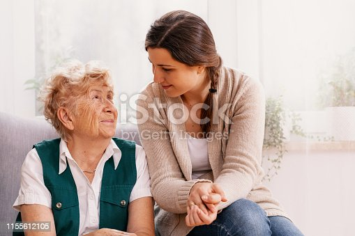 istock Senior woman and helpful volunteer at nursing home 1155612105