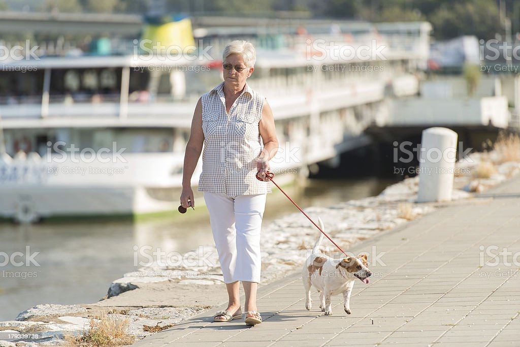 Senior woman and her dog royalty-free stock photo
