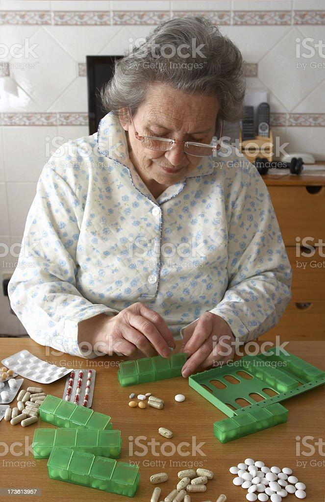 Senior woman and her pills. stock photo