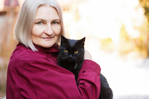 Senior woman and the black cat picture id696521776?b=1&k=6&m=696521776&s=612x612&w=0&h=i8sg06wneltyw1qjvl 4h1ovf57vgzthlx0tn25ekqe=