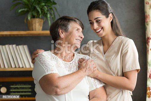 istock Senior woman and younger friend 892893808