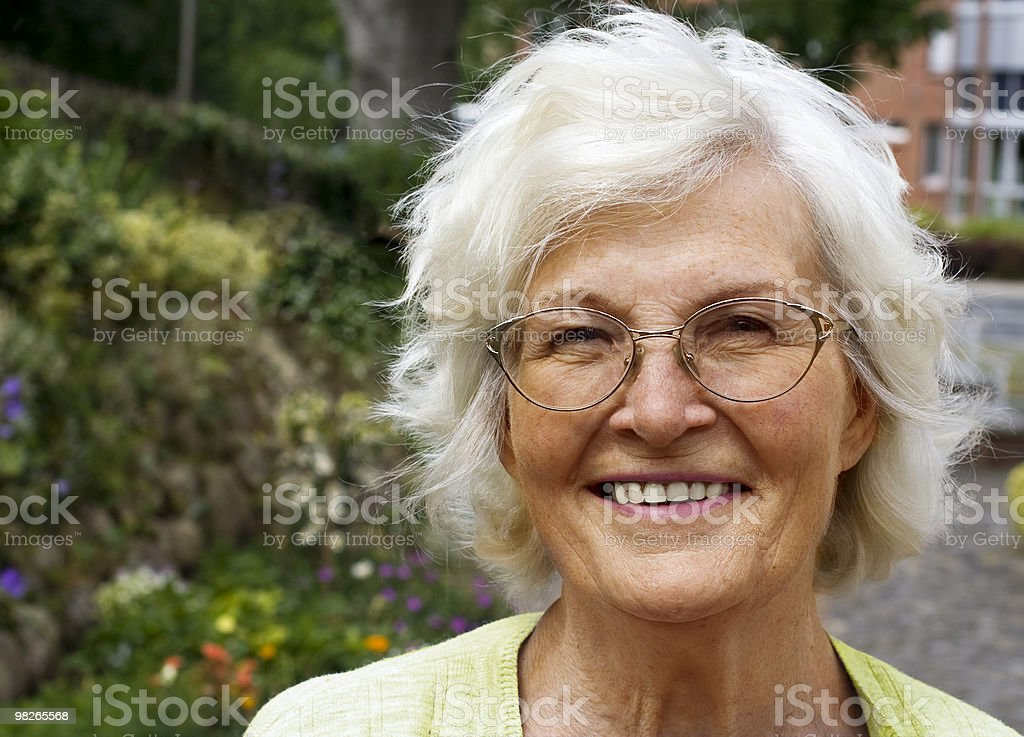 Senior woman appears happy in her golden years royalty-free stock photo