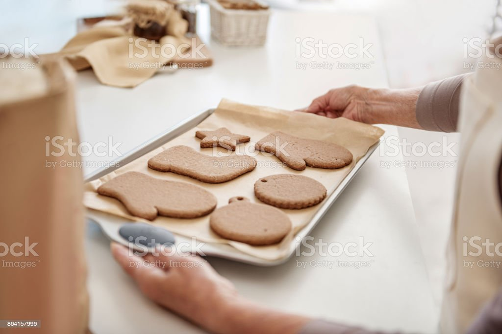 Senior woman arms holding undersell with self-made pastry royalty-free stock photo
