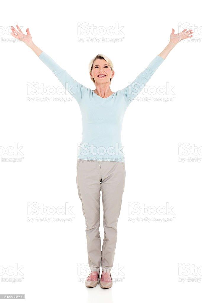 senior woman arms open stock photo