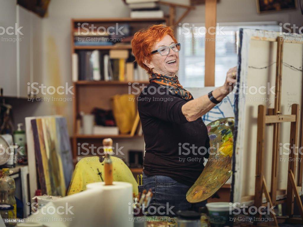 Senior woman artist at work stock photo