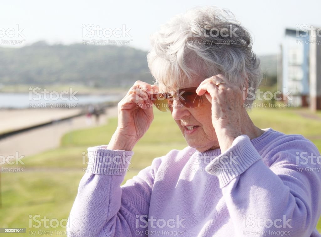 senior woman at beach zbiór zdjęć royalty-free