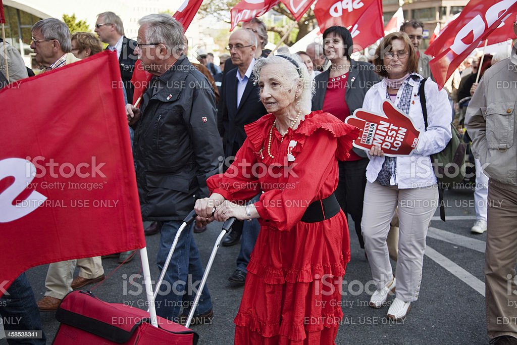 senior woman at demonstration stock photo