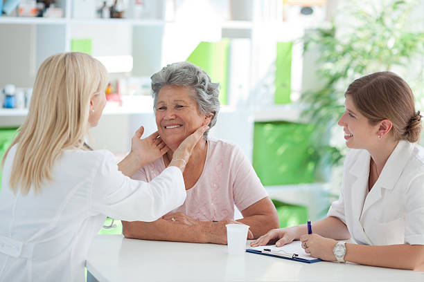 Senior woman at doctor's office. stock photo