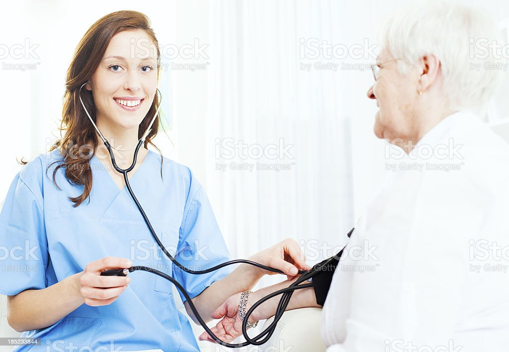 Senior Woman at doctors office. stock photo