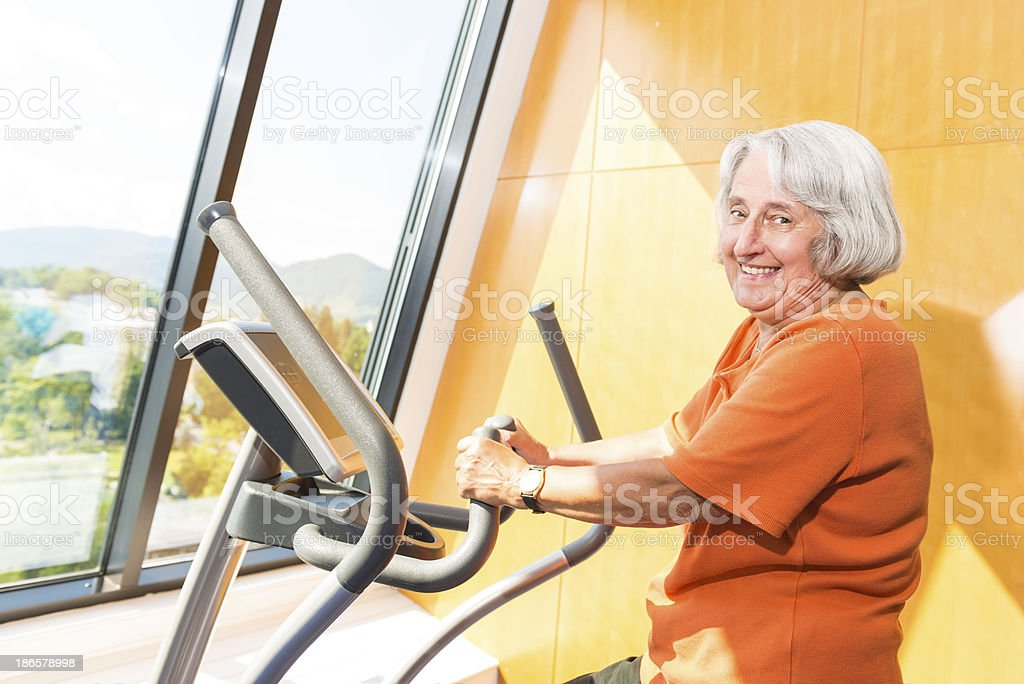 Senior woman at fitness royalty-free stock photo