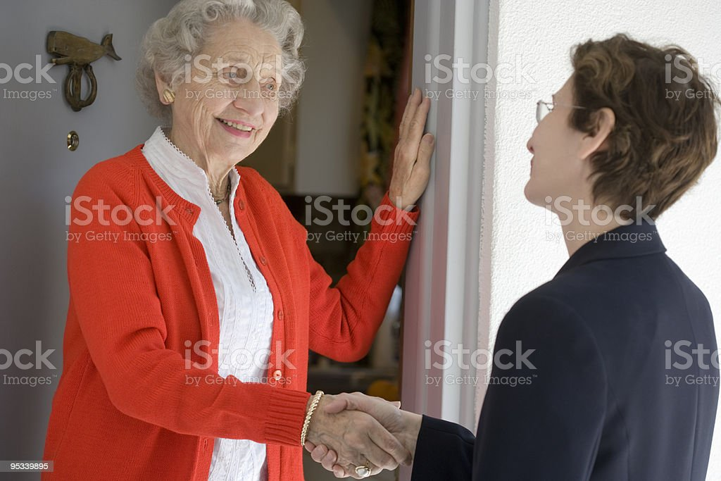 Senior woman at front door stock photo